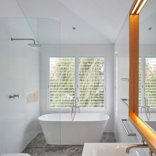 This is an example of a contemporary 3/4 wet room bathroom in Other with a freestanding tub, white walls, a drop-in sink, grey floor, an open shower and grey benchtops.