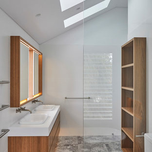 Inspiration for a contemporary 3/4 bathroom in Other with flat-panel cabinets, medium wood cabinets, white walls, a drop-in sink, grey floor and white benchtops.