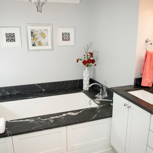 Coastal bathroom photo in Atlanta with an undermount sink, marble countertops, an undermount tub and white walls