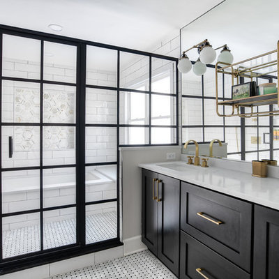 Large transitional master white tile and subway tile mosaic tile floor and white floor tub/shower combo photo in New York with shaker cabinets, black cabinets, an undermount tub, white walls, an undermount sink, a hinged shower door and white countertops