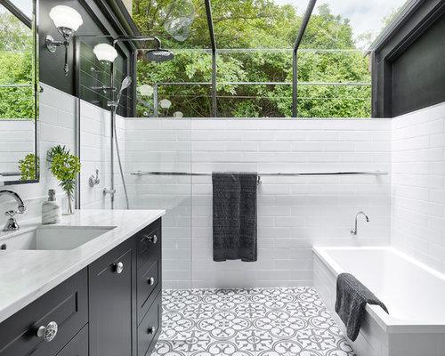 inspiration for a mid sized transitional master black and white tile porcelain floor bathroom remodel - Matchstick Tile Castle 2016