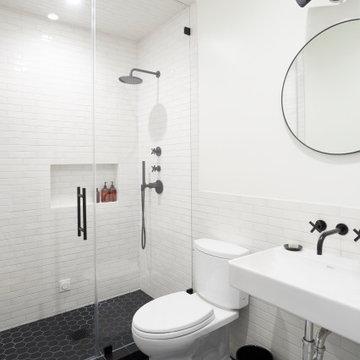 Black and White Tile Bathroom with Frameless Shower Door