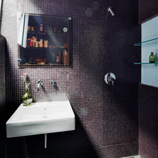 Photo of a small contemporary 3/4 wet room bathroom in New York with glass-front cabinets, a wall-mount toilet, mosaic tile, purple walls, mosaic tile floors, a wall-mount sink, purple floor, an open shower, a single vanity and a built-in vanity.