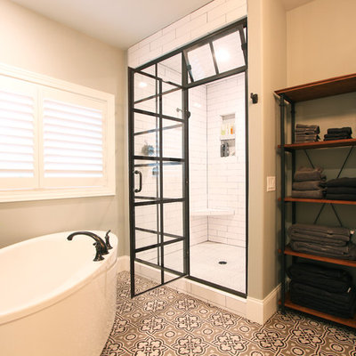Inspiration for a mid-sized transitional master white tile and porcelain tile cement tile floor and multicolored floor bathroom remodel in Other with recessed-panel cabinets, gray cabinets, a one-piece toilet, gray walls, an undermount sink, quartz countertops and a hinged shower door