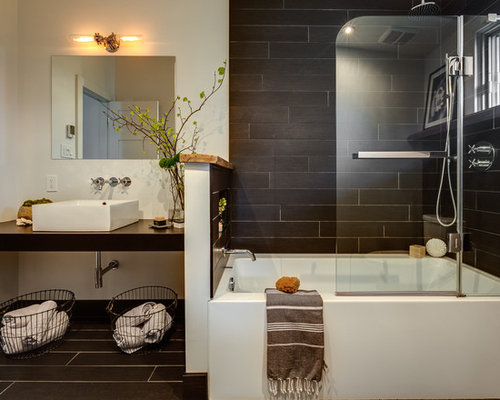 small contemporary black tile and porcelain tile porcelain floor bathroom idea in montreal with a two