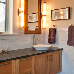 Foto de cuarto de baño principal, de estilo americano, grande, con armarios con paneles empotrados, puertas de armario de madera oscura, bañera encastrada, ducha a ras de suelo, paredes blancas, suelo de baldosas de cerámica y lavabo sobreencimera