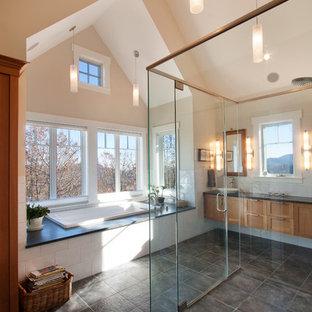 Ejemplo de cuarto de baño principal, de estilo americano, grande, con armarios con paneles empotrados, puertas de armario de madera oscura, bañera encastrada, ducha a ras de suelo, paredes blancas, suelo de baldosas de cerámica y lavabo sobreencimera