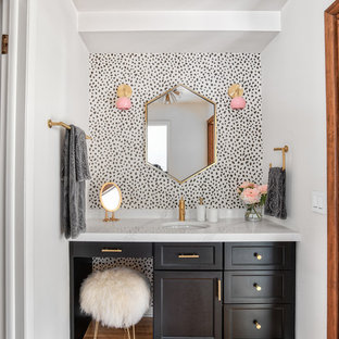 Bathroom - small transitional brown floor and medium tone wood floor bathroom idea in New York with black cabinets, recessed-panel cabinets, white walls, an undermount sink and white countertops