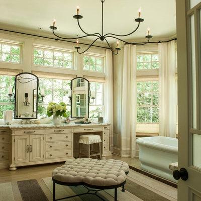 Freestanding bathtub - shabby-chic style master freestanding bathtub idea in Miami with beige cabinets