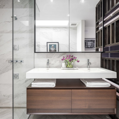 Example of a small minimalist master gray tile and porcelain tile porcelain tile bathroom design in Ottawa with flat-panel cabinets, dark wood cabinets, a two-piece toilet, white walls and an integrated sink