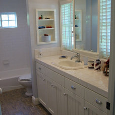 Beach Style Bathroom by Barbara Stock Interior Design