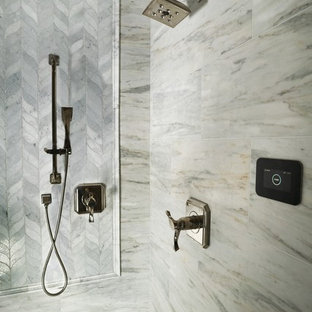 Huge elegant master white tile and marble tile medium tone wood floor and brown floor bathroom photo in San Diego with raised-panel cabinets, white cabinets, a bidet, blue walls, a vessel sink, marble countertops, a hinged shower door and white countertops