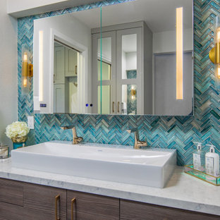 Large master blue tile green floor wet room photo in San Diego with flat-panel cabinets, dark wood cabinets, a one-piece toilet, white walls, a vessel sink, quartz countertops, a hinged shower door and white countertops