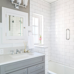Elegant white tile and subway tile bathroom photo in Seattle with recessed-panel cabinets, gray cabinets, gray walls, an undermount sink and engineered quartz countertops