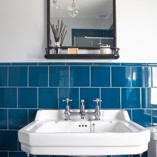 Blue-tiled main bathroom with slipper bath and geometric flooring - Hove