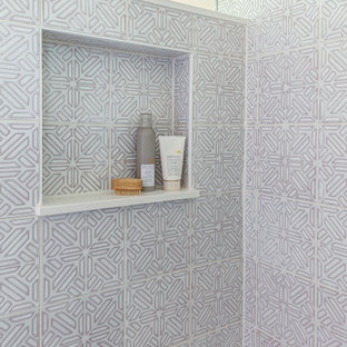Example of a mid-sized transitional kids' white tile and mosaic tile gray floor corner shower design in Chicago with flat-panel cabinets, light wood cabinets, a two-piece toilet, pink walls, an undermount sink, quartz countertops, a hinged shower door and white countertops
