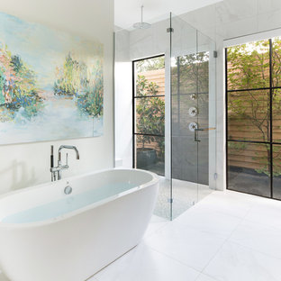 Inspiration for a large contemporary master white tile and marble tile white floor and marble floor bathroom remodel in Dallas with white walls, a hinged shower door, flat-panel cabinets, medium tone wood cabinets, an undermount sink, solid surface countertops and white countertops