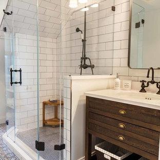 На фото: ванная комната среднего размера в стиле лофт с коричневыми фасадами, угловым душем, белой плиткой, белыми стенами, врезной раковиной, синим полом, душем с распашными дверями и белой столешницей с