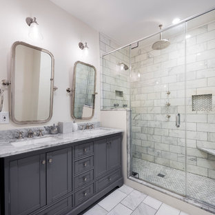 Inspiration for a mid-sized transitional master white tile and subway tile bathroom remodel in Philadelphia with white walls, shaker cabinets, gray cabinets, an undermount sink and a niche