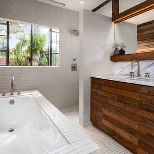 Inspiration for a small contemporary master white tile and porcelain tile porcelain floor and white floor bathroom remodel in Los Angeles with an undermount sink, medium tone wood cabinets, an undermount tub, a two-piece toilet, white walls and marble countertops