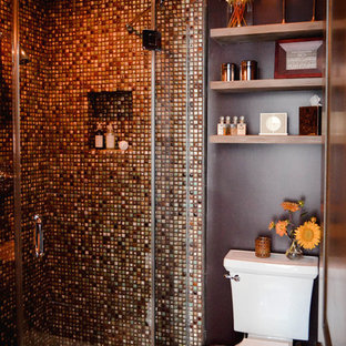 This is an example of a small mediterranean 3/4 bathroom in Los Angeles with open cabinets, medium wood cabinets, a corner shower, a two-piece toilet, multi-coloured tile, ceramic tile, brown walls, porcelain floors, a vessel sink, beige floor and a hinged shower door.