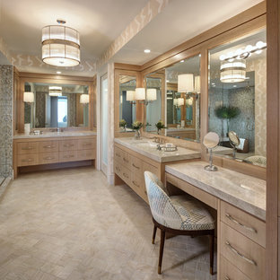 Example of a coastal master beige floor bathroom design in Miami with flat-panel cabinets, light wood cabinets, beige walls and an undermount sink
