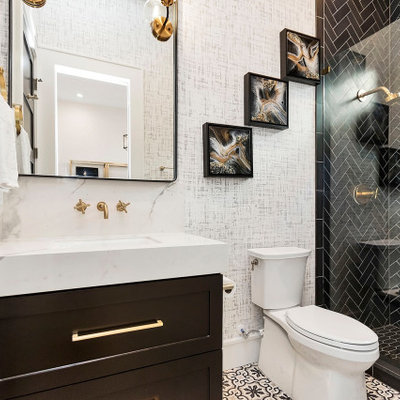 Transitional black tile multicolored floor alcove shower photo in Houston with shaker cabinets, black cabinets, white walls, an undermount sink and white countertops