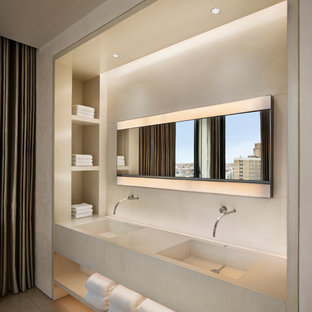 Inspiration for a contemporary bathroom remodel in New York with an integrated sink and concrete countertops