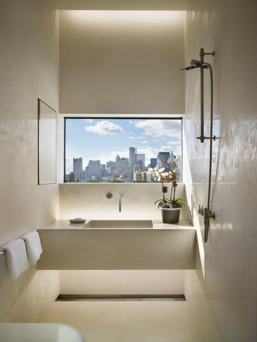Example Of A Trendy Bathroom Design In New York With An Integrated Sink And  Concrete Countertops