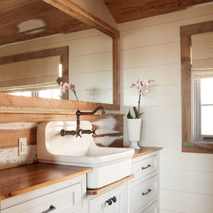 Mountain style brick floor bathroom photo in Richmond with wood countertops and brown countertops
