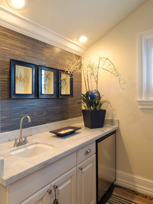 Tropical Bathroom Idea In Miami With An Undermount Sink Raised Panel Cabinets And Beige
