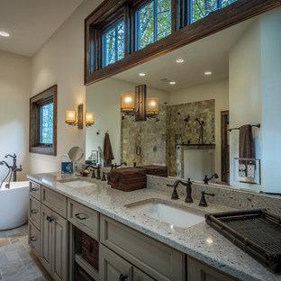 Ispirazione per un'ampia stanza da bagno padronale stile rurale con lavabo sottopiano, ante con riquadro incassato, ante beige, top in granito, vasca freestanding, doccia doppia, WC a due pezzi, piastrelle beige, piastrelle in pietra e pareti bianche