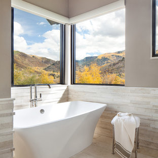 Inspiration for a large transitional master white tile and ceramic tile ceramic floor and white floor bathroom remodel in Denver with beige walls, flat-panel cabinets, white cabinets, an undermount sink and a hinged shower door