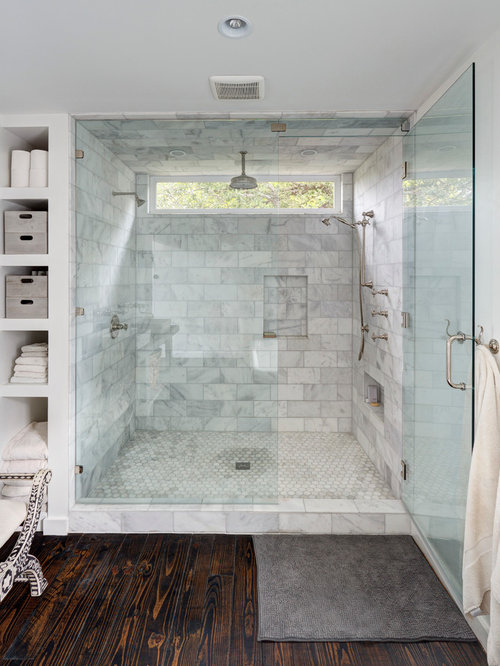 large contemporary master white tile and stone tile dark wood floor alcove shower idea in austin