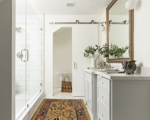 Inspiration For A Mid Sized Master Stone Slab And White Tile Marble Floor  And White