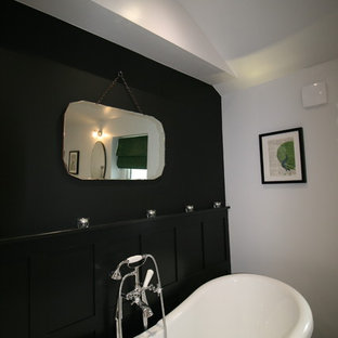 Photo of a medium sized victorian family bathroom in Other with beaded cabinets, dark wood cabinets, a freestanding bath, a corner shower, a two-piece toilet, black and white tiles, porcelain tiles, grey walls, porcelain flooring, a trough sink and marble worktops.