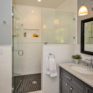 Inspiration for a timeless white tile and subway tile alcove shower remodel in San Francisco with an undermount sink, gray cabinets, gray walls and recessed-panel cabinets
