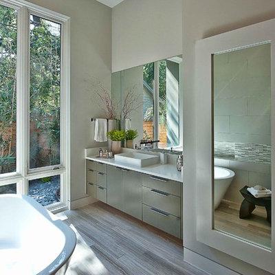 Trendy freestanding bathtub photo in Austin with a vessel sink
