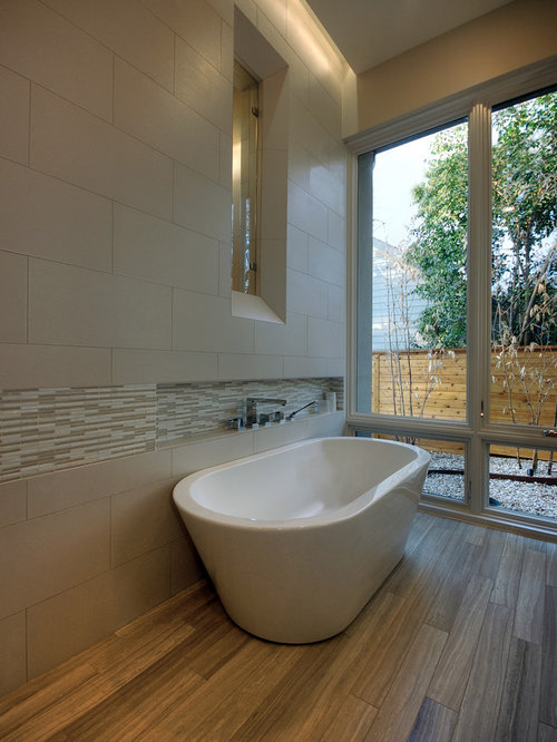 freestanding tub with faucet deck. Example of a trendy travertine tile freestanding bathtub design in Austin Deck Mount Faucet  Houzz