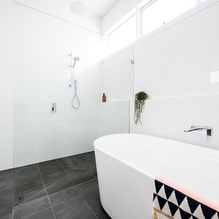 Design ideas for a mid-sized modern 3/4 bathroom with a freestanding tub, a curbless shower, white tile, porcelain tile, white walls, ceramic floors, grey floor and an open shower.