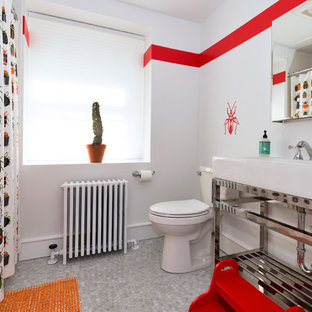 Example of a trendy kids' bathroom design in Philadelphia with a two-piece toilet, red walls and a console sink