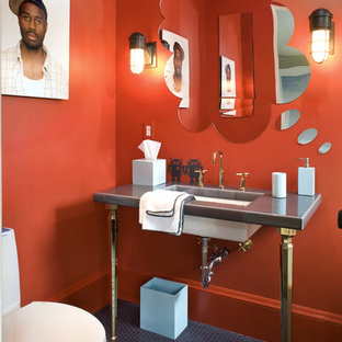 Example of a minimalist bathroom design in San Francisco with a console sink and red walls