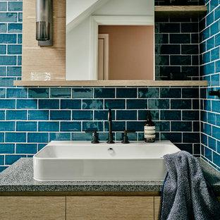 Inspiration pour une petite douche en alcôve design avec des portes de placard en bois brun, un WC suspendu, un carrelage bleu, des carreaux de céramique, un mur bleu, un sol en carreaux de ciment, une grande vasque, un plan de toilette en terrazzo, un sol noir et aucune cabine.