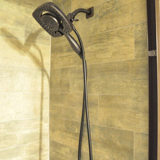 Tub/shower combo - small industrial kids' brown tile and ceramic tile ceramic floor tub/shower combo idea in Atlanta with an undermount sink, shaker cabinets, dark wood cabinets, granite countertops, an undermount tub and a two-piece toilet