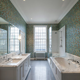 Corner shower - traditional master corner shower idea in London with an undermount sink, recessed-panel cabinets, white cabinets, an undermount tub, multicolored walls and marble countertops