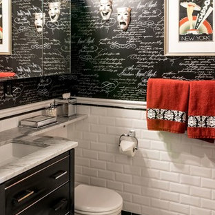Alcove shower - large traditional 3/4 black tile, black and white tile, white tile and subway tile porcelain tile and yellow floor alcove shower idea in New York with flat-panel cabinets, black cabinets, a one-piece toilet, multicolored walls, a drop-in sink and marble countertops