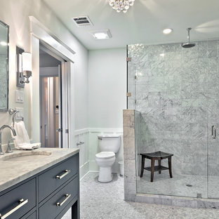 Elegant white tile and stone tile alcove shower photo in Austin with an undermount sink, flat-panel cabinets, gray cabinets and marble countertops