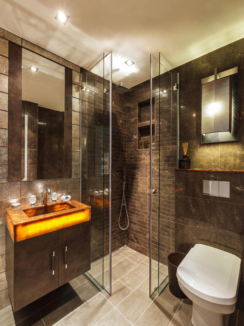 Example of a trendy brown tile corner shower design in London with an  integrated sink,