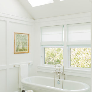 Inspiration for a beach style master ceramic floor freestanding bathtub remodel in Boston with white walls