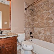 Traditional Bathroom by Joseph Paul Homes